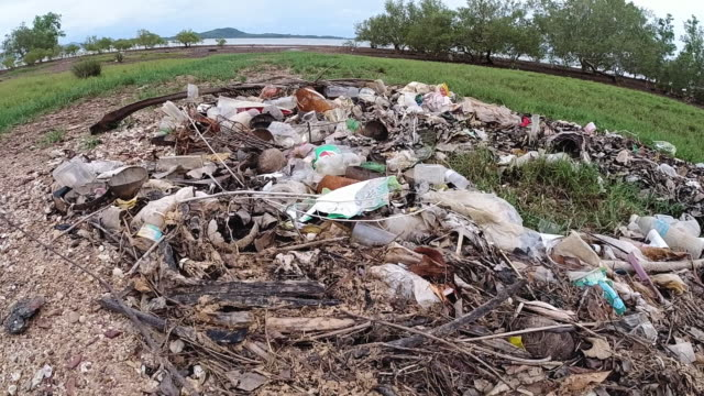 plastic pollution washed up on coastline - littering stock videos & royalty-free footage