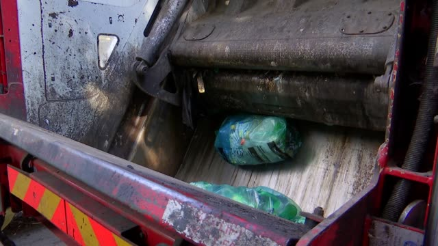 rubbish being collected in hackney park and gvs in plastics recycling centre; england: london: hackney: ext hackney refuse workers collecting rubbish... - bale stock videos & royalty-free footage