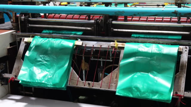 plastic sheet cutting machine - packet stock videos & royalty-free footage