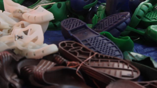 plastic shoes piled up - pair stock videos & royalty-free footage