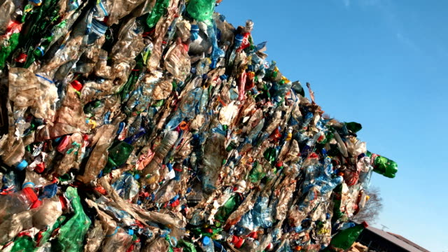 plastic waste against blue sky. - disposal container stock videos and b-roll footage