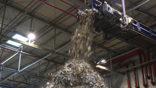 plastic waste falling of conveyor belt in a huge pile - pinaceae stock videos & royalty-free footage