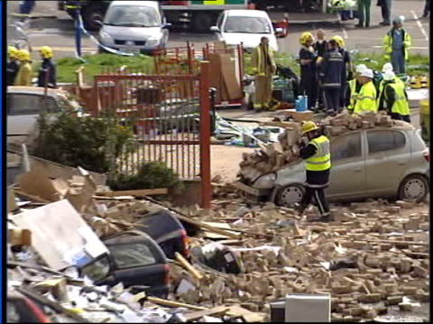 Plastics factory explosion in Glaggow ITN Glasgow Vox pops eyewitness SOT MS Car covered by rubble PULL OUT more MS Collapsed building BV Firemen...
