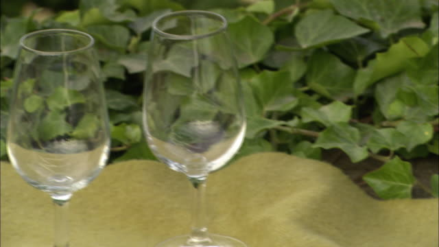 A plate displays typical antipasto foods near empty wine glasses in Florence, Italy.