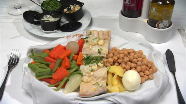 a plate of bacalhau cozido in lisbon, portugal - portuguese culture stock videos & royalty-free footage