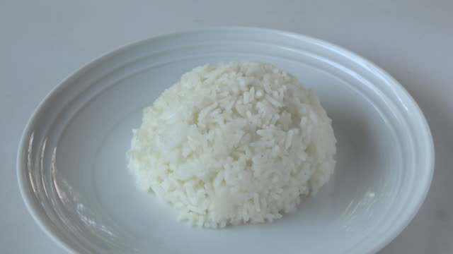 plate of boiled rice - boiled stock videos and b-roll footage