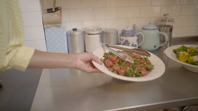 a plate of food is picked up - slow motion - overexposed stock videos & royalty-free footage