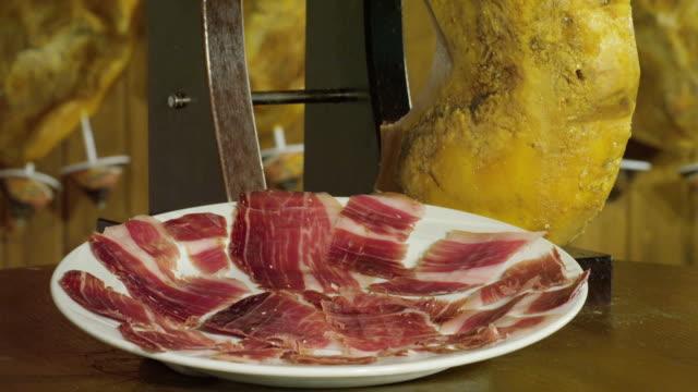 CU TU plate of Pata Negra ham and ham on slicing stand