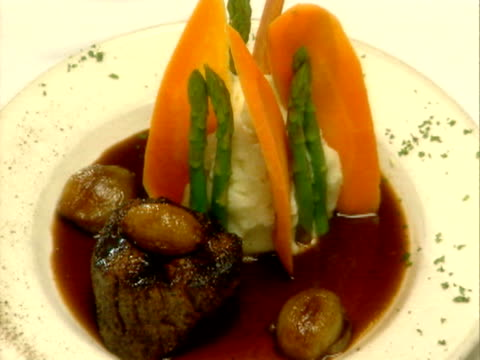 a plate of venison with mashed potatoes and carrots - mashed potatoes stock videos & royalty-free footage