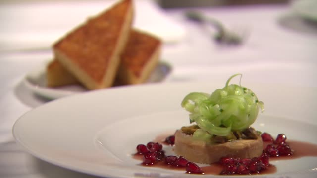 plated foie gras with curled celery at baffo restaurant at eataly in chicago on jan. 16, 2015. - french food stock videos & royalty-free footage