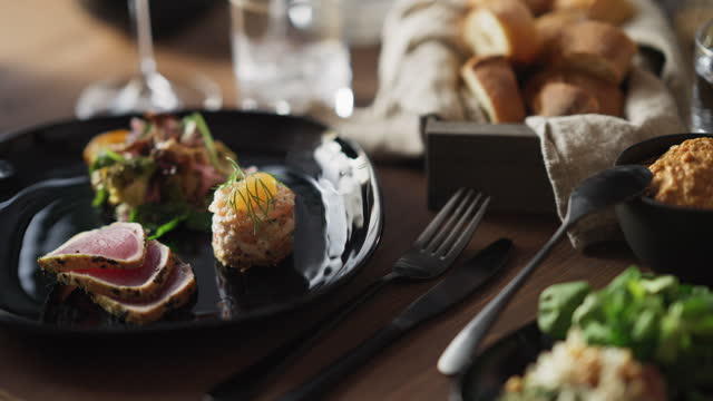 plates full at the dinner table - french food stock videos & royalty-free footage