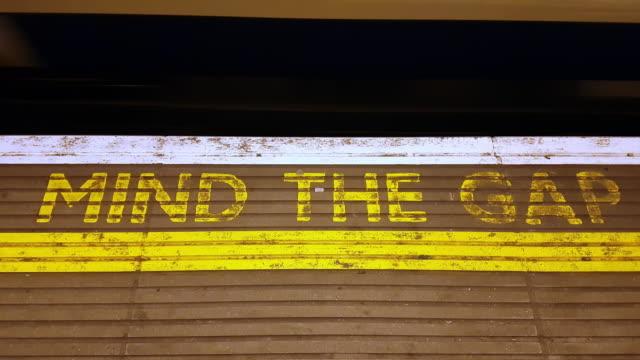 platform gap in london underground station - yellow stock videos & royalty-free footage