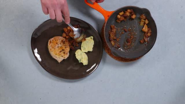 plating cooked apple and turnip. - 顕花植物点の映像素材/bロール