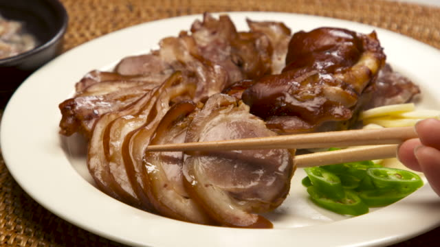 plating 'hanbang jokbal' / south korea - garlic stock videos & royalty-free footage
