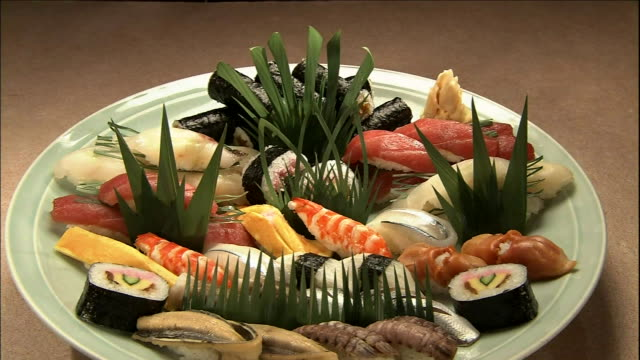 a platter contains an arrangement of sushi items. - nigiri stock videos and b-roll footage