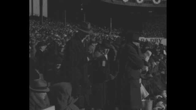 play in progress on field / ny giants on bench with blanket over laps and wearing hats, others behind them / play / play with pass / crowd in stand... - bundle stock videos & royalty-free footage