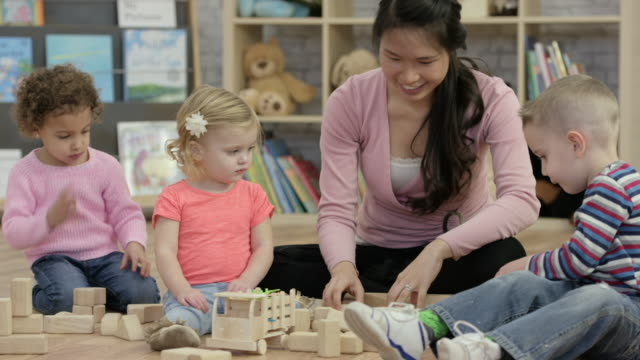 play time at daycare - child care stock videos & royalty-free footage