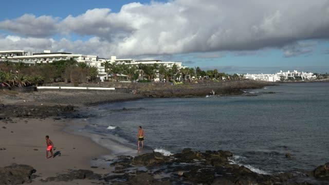 playa blanca, lanzarote, canary islands, spain, atlantic, europe - swimming shorts stock videos & royalty-free footage