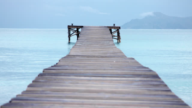 Playa de Muro with long wooden jetty in caribbean coloured water