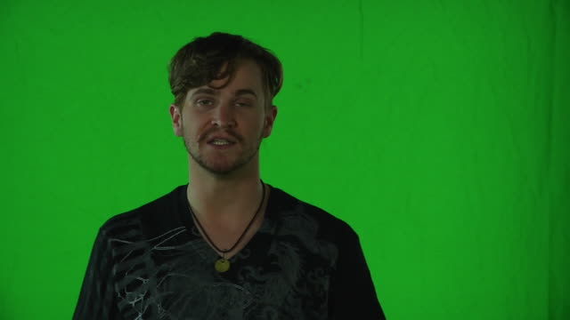 "man posing in front of greenscreen reading ""cocktail's logline"" and talking about his character - chroma key stock videos & royalty-free footage"