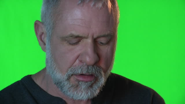 "white bearded man sitting in front of greenscreen recording vo for ""cocktails""; story of the show - chroma key stock videos & royalty-free footage"