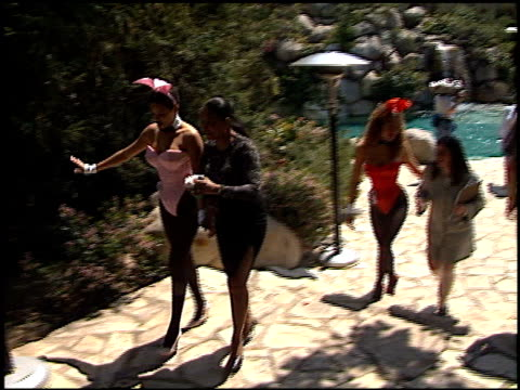 playboy bunnies at the 72nd birthday party for hugh hefner at playboy mansion in los angeles california on april 9 1998 - playboy mansion stock videos & royalty-free footage