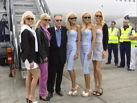 playboy founder hugh hefner poses with various promotional staff at the base of his private aircraft after flying into heathrow from cannes. group... - hugh hefner stock videos & royalty-free footage
