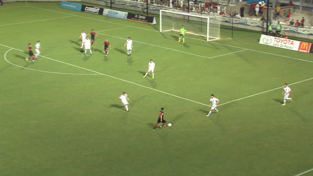 a player appears to score a goal but a referee negates it during a soccer game - real time stock videos & royalty-free footage