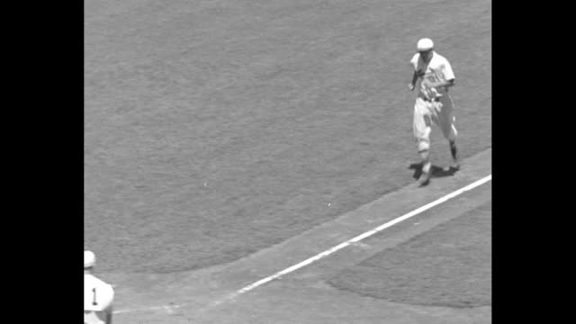 player at bat hits a single during the allstar game at the polo grounds / joe medwick hits home run runs score / ws crowd in upper level of outfield... - 1934 bildbanksvideor och videomaterial från bakom kulisserna
