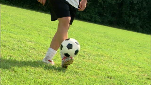 Player balancing soccer ball on foot