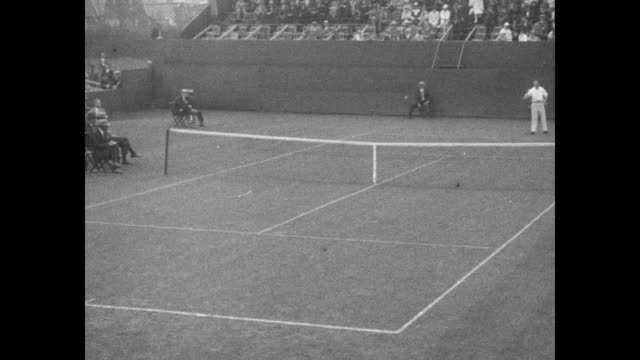 player bill johnston on court at germantown cricket club during the international lawn tennis challenge / slow motion shot of johnston in far court... - davis cup stock-videos und b-roll-filmmaterial