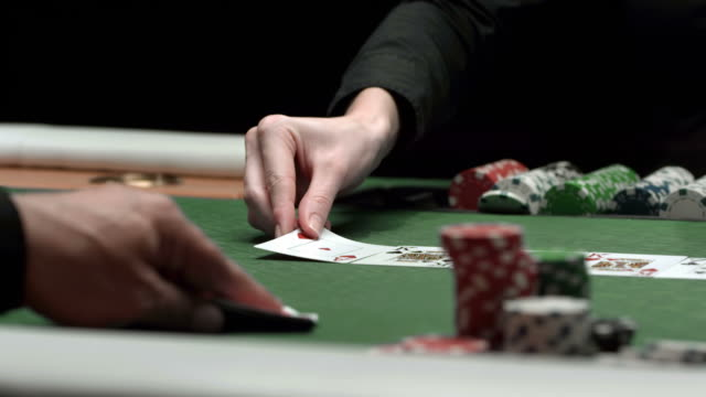 hd dolly: player checking hole cards with two aces - gambling chip stock videos and b-roll footage