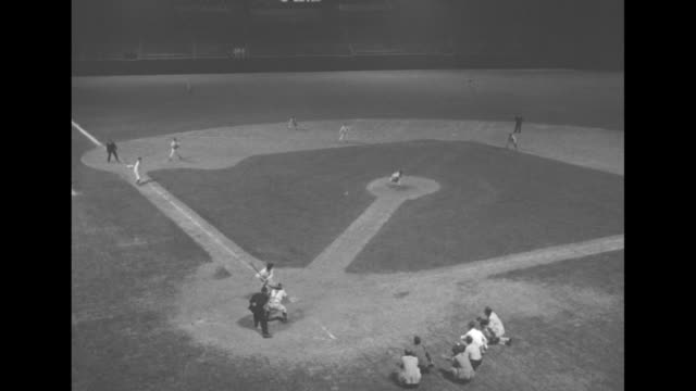 player draws a walk as republicans face democrats in the congressional baseball game; all players wear washington senators uniforms / foul ball; high... - inning stock videos & royalty-free footage