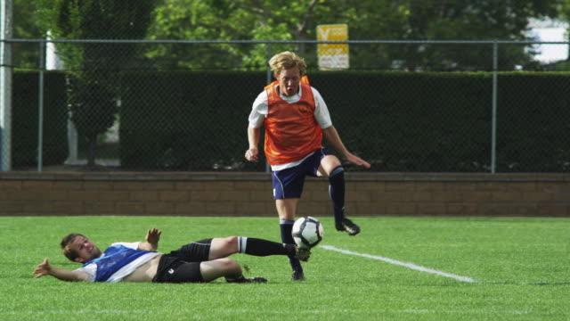 vídeos de stock e filmes b-roll de ms pan player dribbling ball across soccer  field / provo, utah, usa - provo