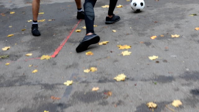 player dribbling soccer ball amidst athletes - soccer player stock videos & royalty-free footage