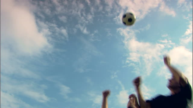 Player head-butting soccer ball