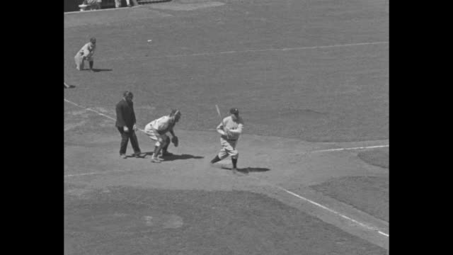 player hits a double during the allstar game at the polo grounds in new york city / babe ruth grounds out for the american league / lou gehrig... - 1934 bildbanksvideor och videomaterial från bakom kulisserna