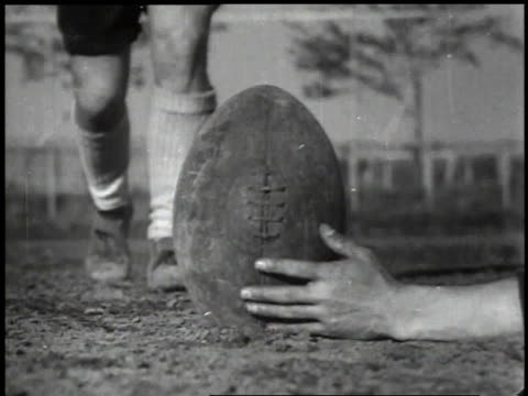 1939 montage player kicking football on ground then teams playing each other in a game of rugby / japan - reportage stock videos & royalty-free footage