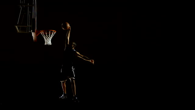 player performing a slam dunk (super slow motion) - shooting baskets stock videos and b-roll footage