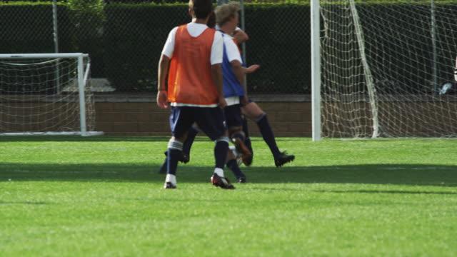 ws pan slo mo player scoring goal on field / provo, utah, usa - provo stock videos & royalty-free footage