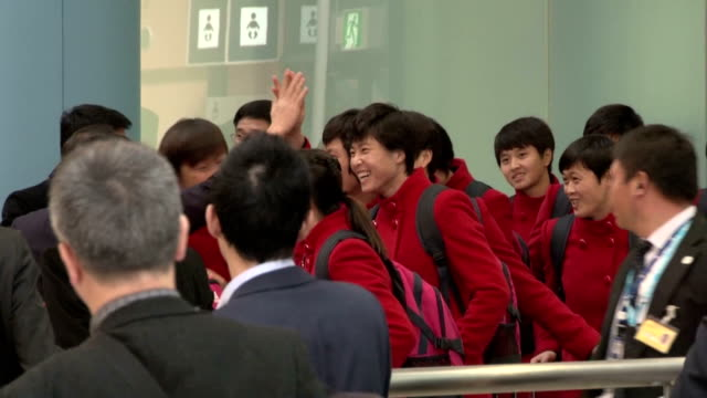 players and officials of the north korean women's soccer team arrive at kansai international airport in osaka prefecture on feb. 25, 2016. they were... - international team soccer stock videos & royalty-free footage