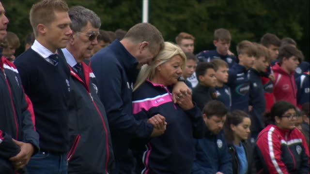 players and staff at east grinstead rfc observing a moments silence for murdered policeman matiu ratana, who was also a coach at the club - crime and murder stock videos & royalty-free footage