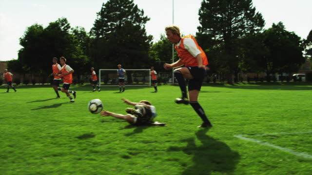 vídeos de stock e filmes b-roll de ws slo mo pan players dribbling ball across soccer field / provo, utah, usa - provo
