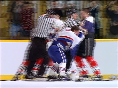 players fighting on ice hockey rink as referees try to break it up - fight stock videos & royalty-free footage