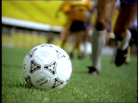 a player's foot kicks a soccer ball during a free kick and other players follow. - colombia stock videos & royalty-free footage