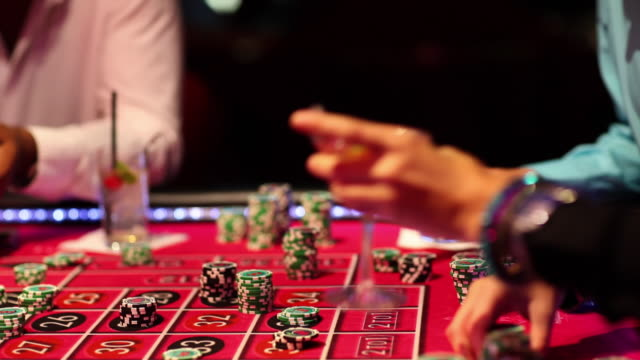 ms players holding drink and playing at roulette table / las vegas, nevada, usa - roulette stock videos & royalty-free footage