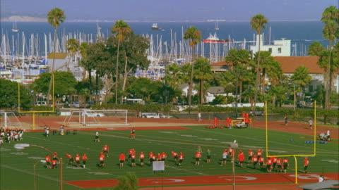 ws players in santa barbara city college football field / california, usa - santa barbara california stock videos & royalty-free footage