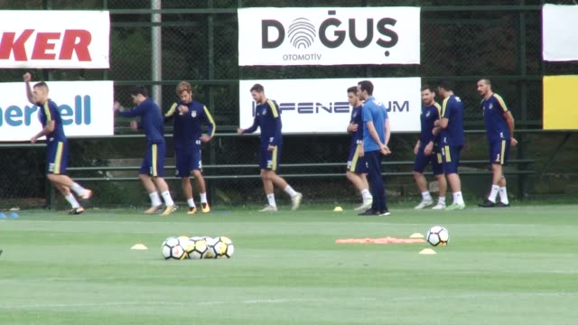 Players of Fenerbahce attend a training session at the Fenerbahce Can Bartu Sports Facilities ahead of UEFA Europa League playoff match between...