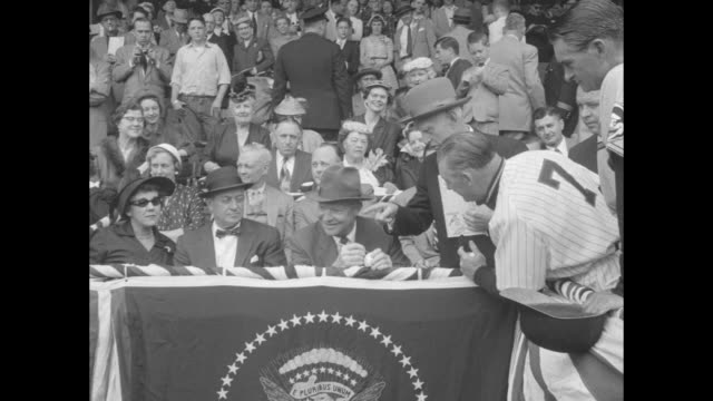 players on griffith stadium field warm up before game between washington senators and baltimore orioles / crowd in stands / us president dwight d.... - inning stock videos & royalty-free footage