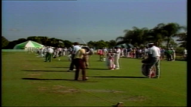 players prepare for the us pga championship; usa: florida: palm springs: ext cms side nick faldo in position to hit ball faldo putting on green l-r... - drive ball sports stock videos & royalty-free footage